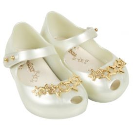 Cream shoes with gold stars